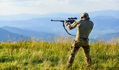 Nice Shot. Army Forces. Hunter Hold Rifle. Hunter Mountains Landscape Background. Focus And Concentr poster