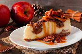 Caramel Apple Pecan Cheesecake.  Close Up Side View With A Rustic Wood Background. Autumn Dessert. poster