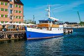 Boat At Havnepromenade On Copenhagen Harbor In Denmark. poster