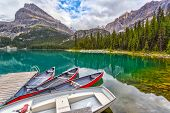 Boats On Dock At Lake Ohara In The Canadian Rockies Of Yoho National Park poster