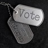 Old and worn military dog tags - Vote in Honor of a Veteran poster