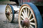 foto of stagecoach  - Wheels from an old stagecoach. Left out in the elements.