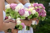 foto of flower girl  - Row of bridesmaids holding bouquets at wedding ceremony - JPG