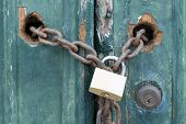 Padlock And Chain On An Old Door, Illustrating Concepts Of Security And Encryption poster