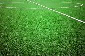 image of football pitch  - football grass background in light and shadow  - JPG