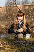 Teen Girl Recording Geocaching Logbook