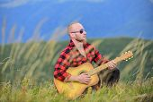 Man With Guitar On Top Of Mountain. In Unison With Nature. Keep Calm And Play Guitar. Acoustic Music poster