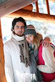 picture of chalet  - Couple stood hugging on chalet patio - JPG