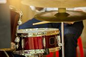 Drum Set With Blurry Hand And Wooden Drumsticks In Recording Studio At Music Academy Or On Stage. poster