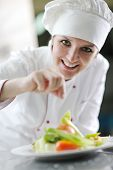 image of chef cap  - beautiful young chef woman prepare and decorating tasty food in kitchen - JPG