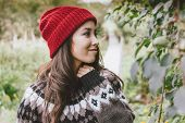 Beautiful Carefree Long Hair Asian Girl In The Red Hat And Knitted Nordic Sweater In Autumn Nature P poster