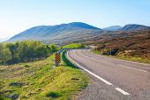 Winding  road through the Scottish Highlands in the morning, United Kingdom. Typical Scottish mounta poster