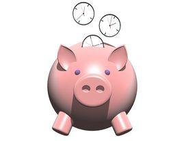 foto of time-saving  - metaphor image of a piggybank whit clock coin - JPG