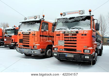 Row Of Orange Scania Trucks