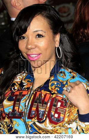 LOS ANGELES - FEB 4:  Tiny, aka Tameka Harris, aka Tameka Cottle arrives at the 'Identity Theft' Premiere at the Village Theater on February 4, 2013 in Westwood, CA