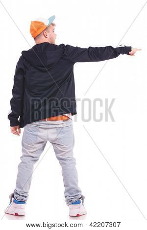 full length back view picture of a young man pointing and looking to his side, on white background