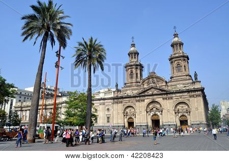 SANTIAGO - FEBRUARY 1, 2012: Summer brings tourists to downtown Santiago. Visitors gather in front of the Santiago Cathedral at Plaza de Armas in the city�¢�?�?s historic center on February 1, 2013.