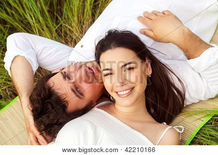 Happy Young Smiling Couple On The Summer Meadow