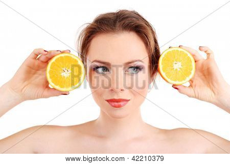 Beautiful young woman with bright make-up, holding orange, isolated on white