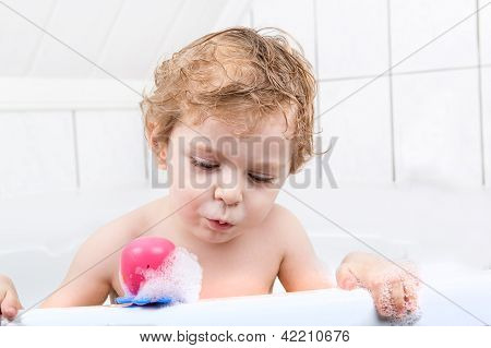 Adorable Toddler Boy Having Fun In Bathtub