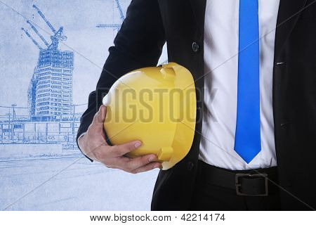 Businessman And Safety Helmet