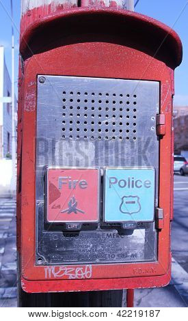 Emergency Reporting System box with buttons to notify the police and fire department