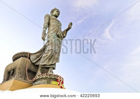 Walking Buddha Against  Blue Sky