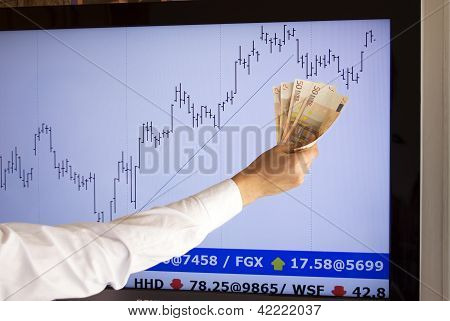 stockbroker giving approval with a euros in hand (fictitious market data)