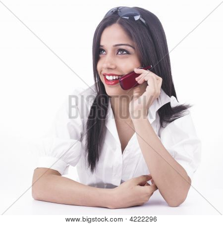 Asian Girl Talking On The Cell Phone