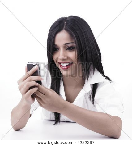 Asian Girl Looking At Her Cell Phone