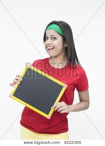 Beautiful Young Woman With A Black Board