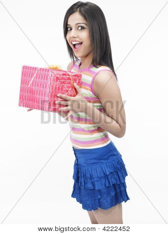 Asian Girl Of Indian Origin With A Gift Box