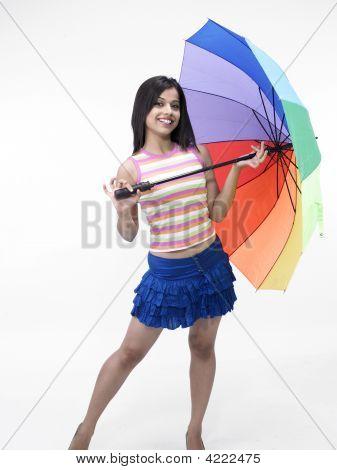 Asian Girl Of Indian Origin With Rainbow Umbrella