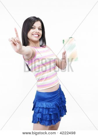 Asian Girl Of Indian Origin With Pack Of Juice