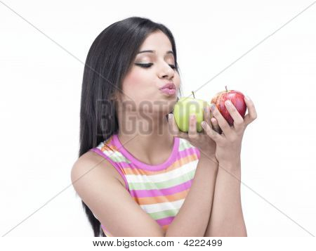 Asian Woman Of Indian With Green And Red Apple