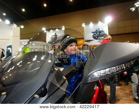 Hamburg, Germany - January 26: The Little Boy On A Motorbike  On January 26, 2013