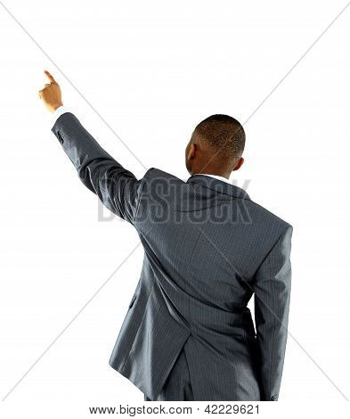 Afroammerican businessman points finger up. Isolated on white background