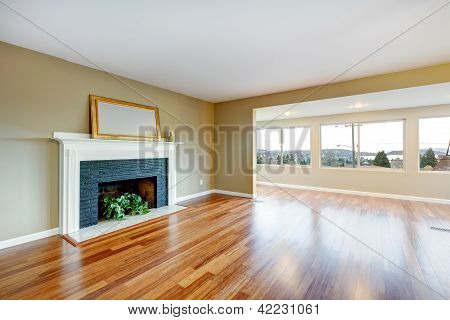 Living Room In A New Empty House With Fireplace.