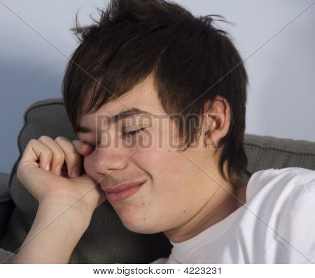 Teenage Boy Sleeping On Couch