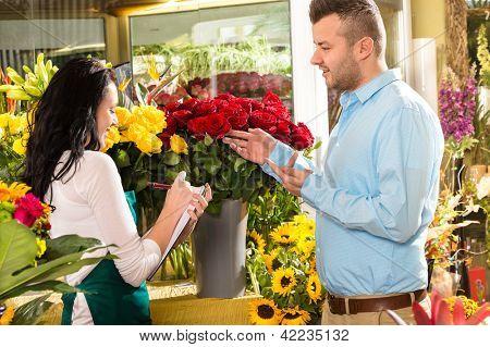 Man customer ordering flowers bouquet flower shop florist