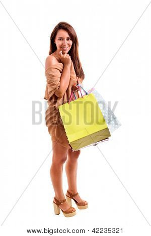 Beautiful lovely woman with shopping bags over white background