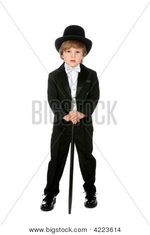 Handsome Young Boy In Black Tuxedo And Tophat