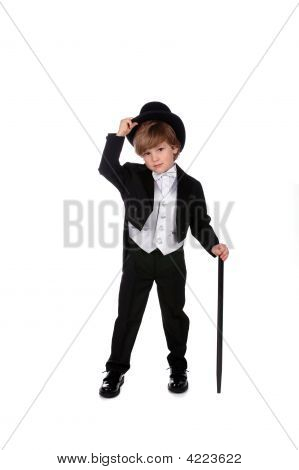 Young Boy In Tux Tipping His Hat