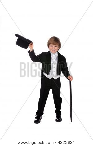 Playful Young Boy In Black Tux Lifting Off His Hat