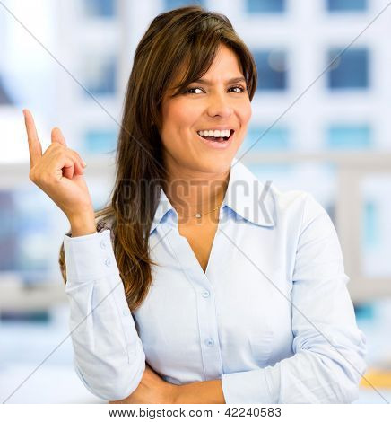 Business woman having a great idea at work