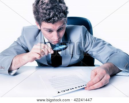 Portrait Of A Handsome Expressive Man Looking At A Contract