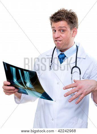 Expressive Doctor Examining Broken Foot X-ray