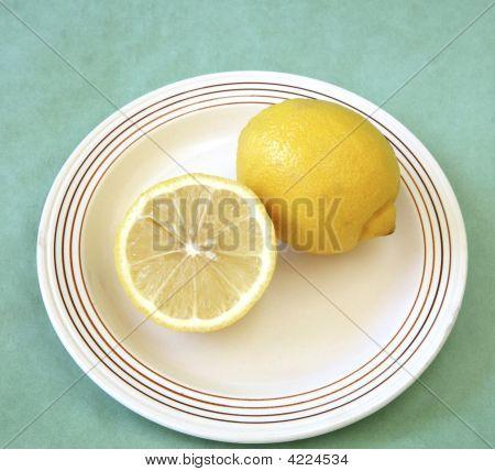 Whole And Half Lemon On Plate