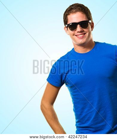 Portrait Of Young Smiling Man against a blue background