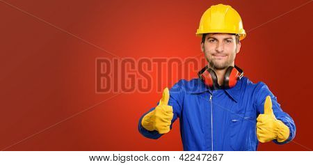 Engineer With Thumb Up Sign Isolated On Red Background